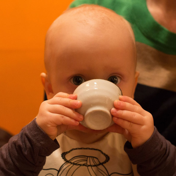 Happy toddler drinking quietly